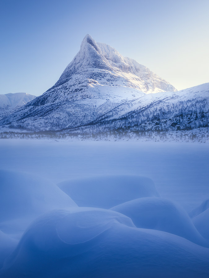 A winter covered Innerdalstårnet in Innerdalen, Norway.